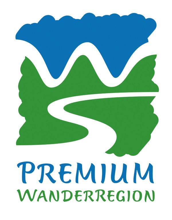 Das grünblaue Logo zeigt, dass das Tecklenburger Land eine Premiumwanderregion ist.